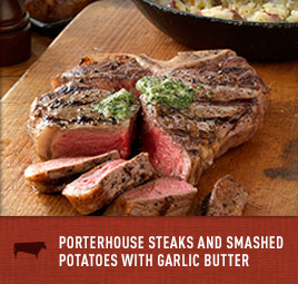 Porterhouse Steaks and Smashed Potatoes with Garlic Butter